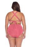 Model posing in the BECCA ETC Color Code Women's pink baked blush colored plus-sized vintage bikini bottom swimsuit
