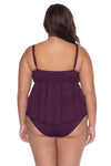 Model posing in the BECCA ETC Color Play Women's merlot colored plus-sized tankini swimsuit top