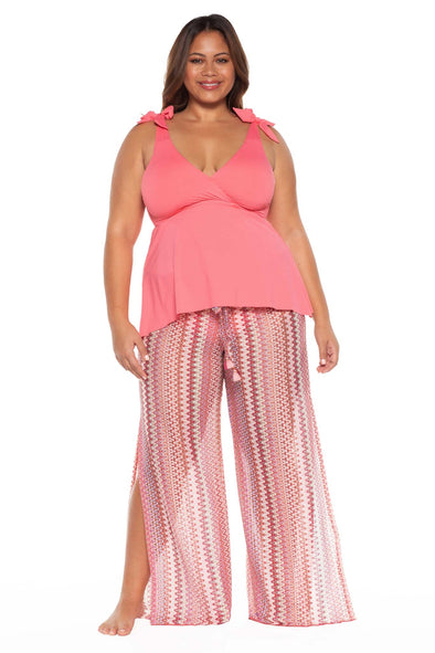 Model posing in the BECCA ETC Pierside Women's geranium colored plus-sized pant