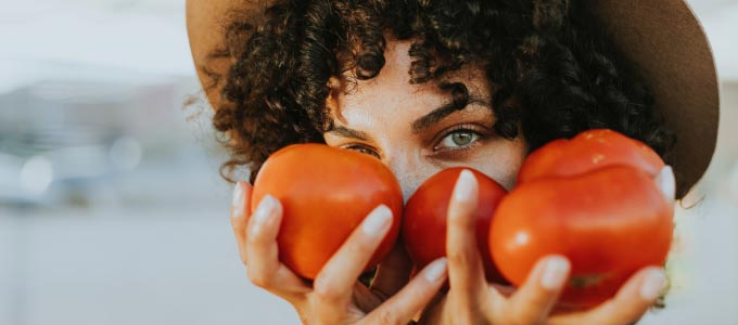 Summer Food Ideas - Woman Holding Tomatoes