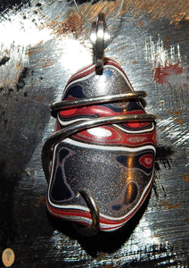 Fordite in Sterling Silver Tension Wrapped Pendant