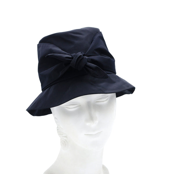 Natalie Suarez navy bucket hat by Genevieve Rose Atelier