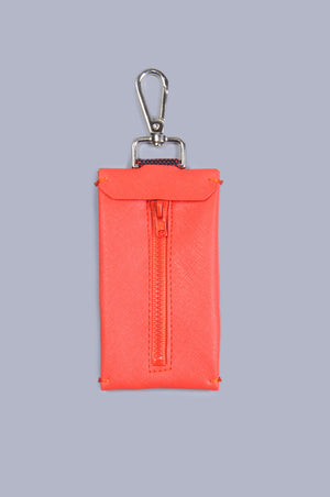 Back view of a red vegan leather dog waste bag holder, with zip and silver clip.