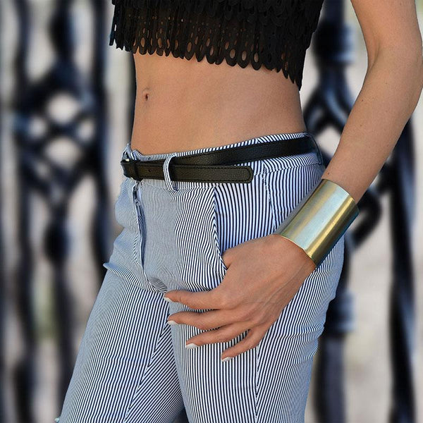 girl with blue trouser wearing 3rdfloor handmade-jewellery wide cuff silver