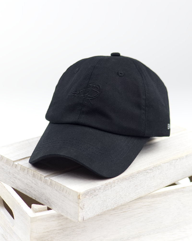 Black Finch Midnight Unisex Dad Hat in black front view on white crate.