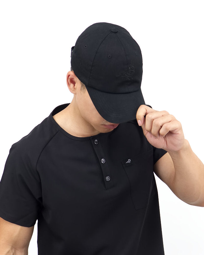 Black Finch Midnight Unisex Dad Hat in black front view on a male model.