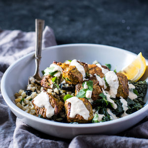 Pork Souvlaki with Tahini Sauce over Kale & Cauliflower Rice with Olives