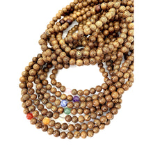 Load image into Gallery viewer, Materials include 108, 8mm light-weight sustainable wood beads that are strung on an elastic (stretch) cord for comfort & durability