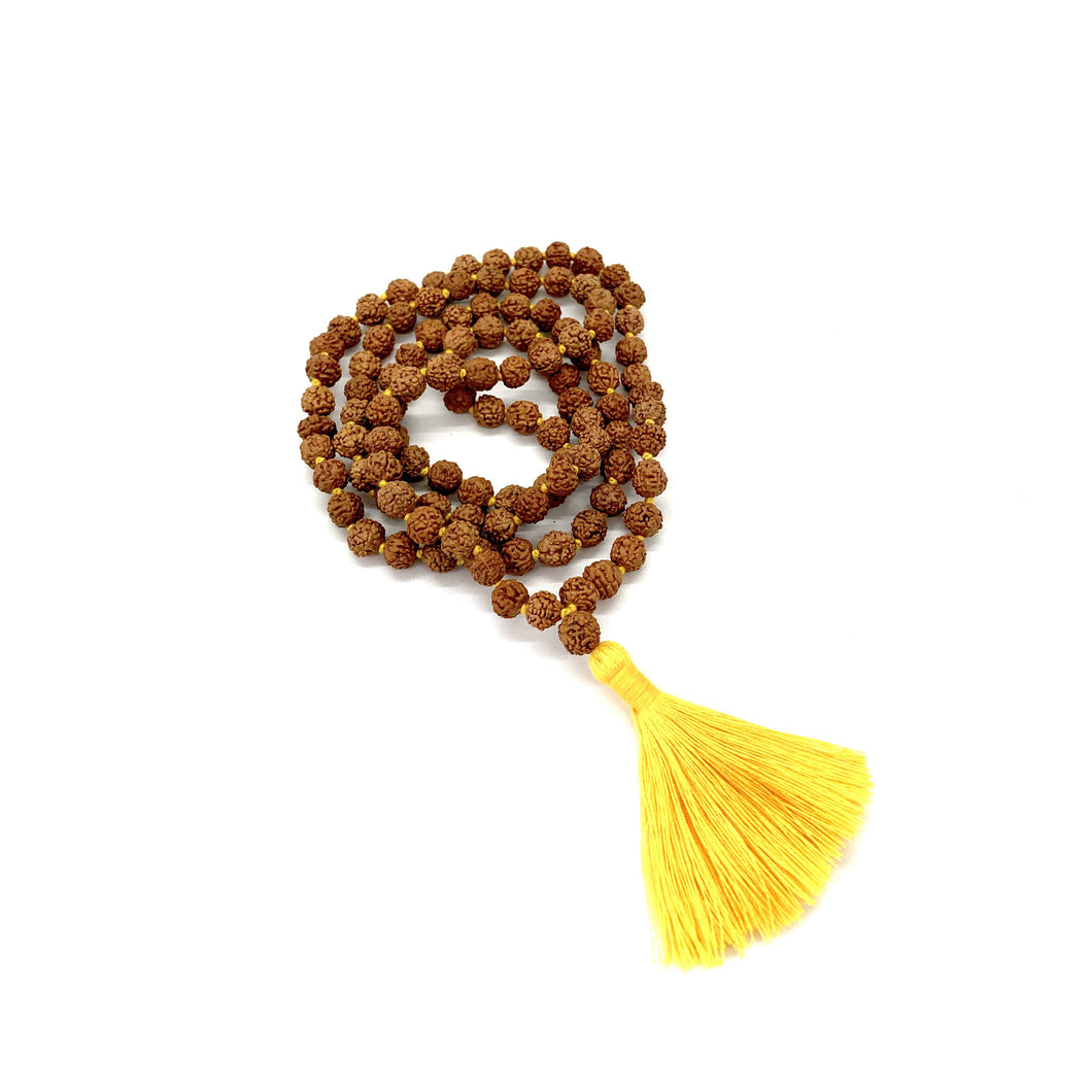Materials include 108, 7mm rudraksha beads that are hand knotted on a yellow cotton string w/ a two-inch yellow cotton tassel for solar plexus energy
