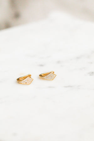 Find the perfect pair of earrings you're looking for from Charme Silkiner! These 14k gold filled earrings with cz pave huggies are seriously stunning. Perfect to dress or dress down any outfit the Avel Earrings are the perfect must have for everyone!