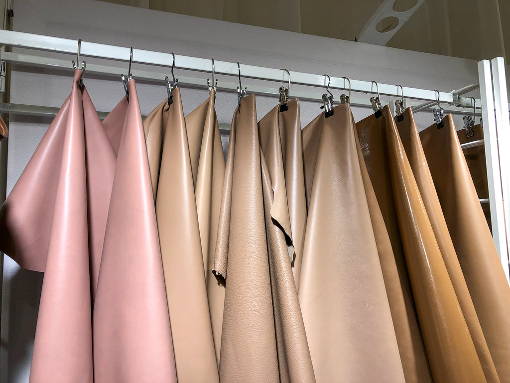 Blush and tan hanging leather display at Lineapelle.