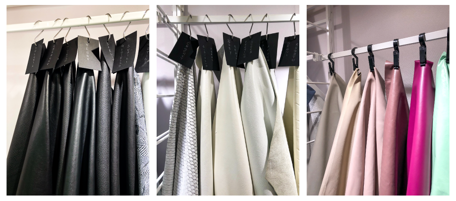 Black, white and colorful hanging leather displays at Lineapelle.