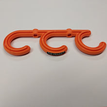 Load image into Gallery viewer, front image of tidi-hook, a triple hook safety product from temporary extension cords