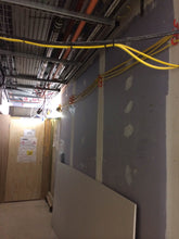 Load image into Gallery viewer, corridor kept safe from trip hazard by using tidi-hook to elevate cords