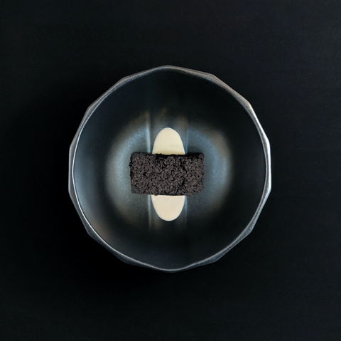 Brownie served in a Solid Black Channel Bowl