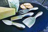 Oval slate board with a variety of cheese showcasing Swissmar 3 Pc Mini Cheese Knife Block Set