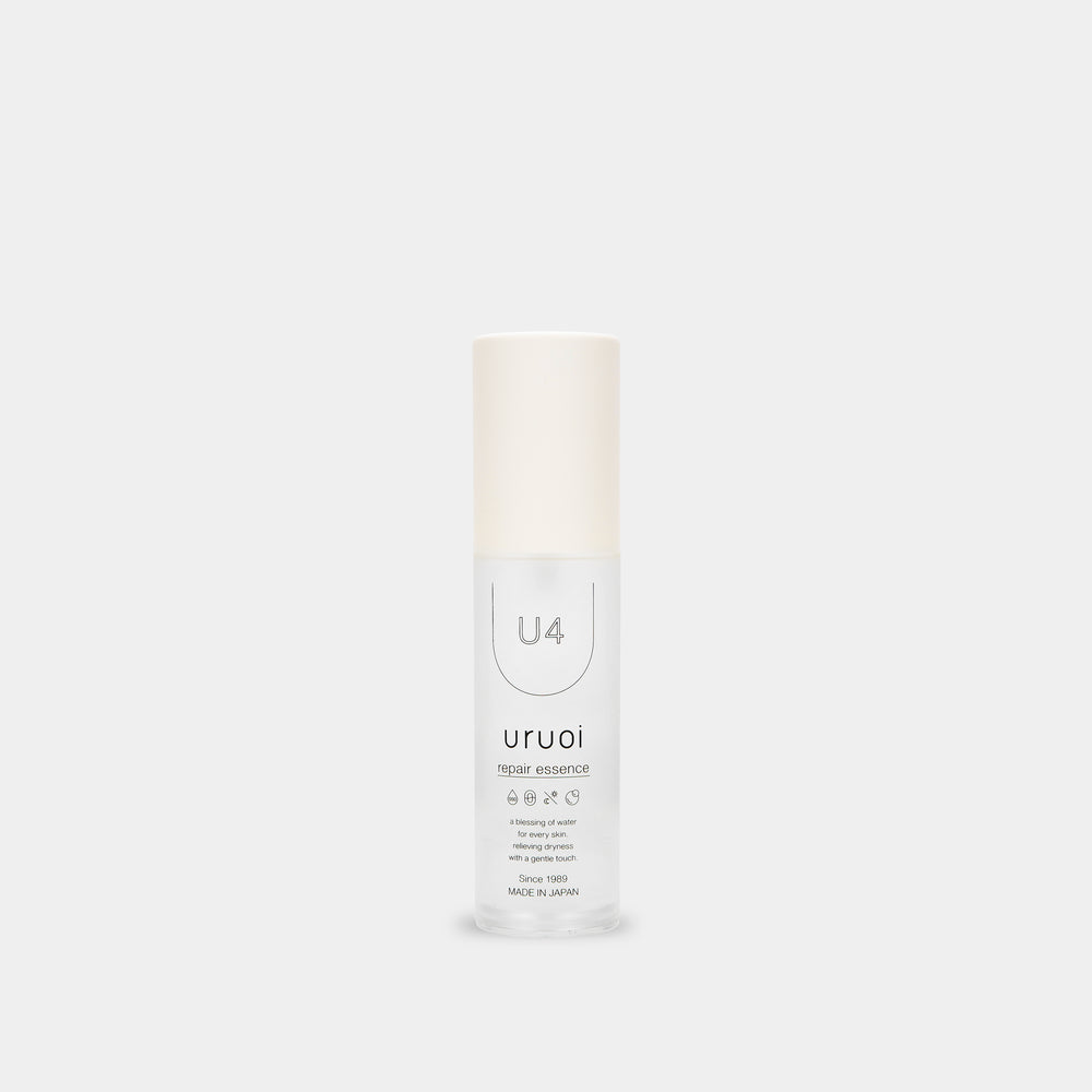 minimalistic monotone forward facing product box and bottle side by side that says 'repair essence' with light gray white background