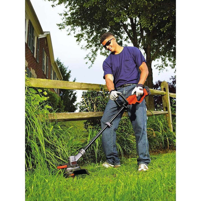 Black and Decker LST400 String Trimmer used in the front lawn
