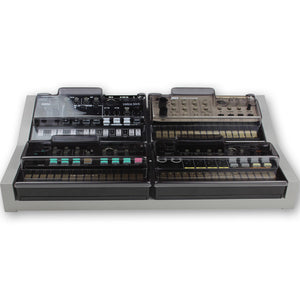 grey fonik stand for 4 korg volca shown with decksaver covers