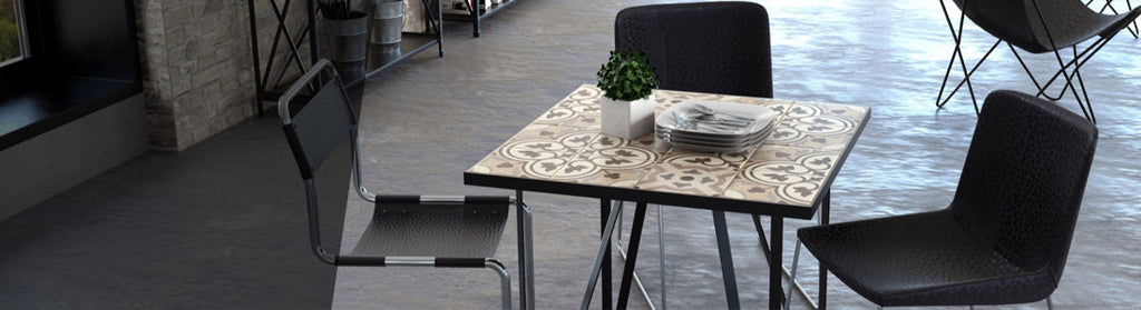Ceramic tiled dining table with grey legs and black fillings