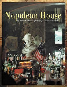 Book cover shows historic Napoleon House bar with a small Napoleon statue overlooking bar patrons with mirror in the background.
