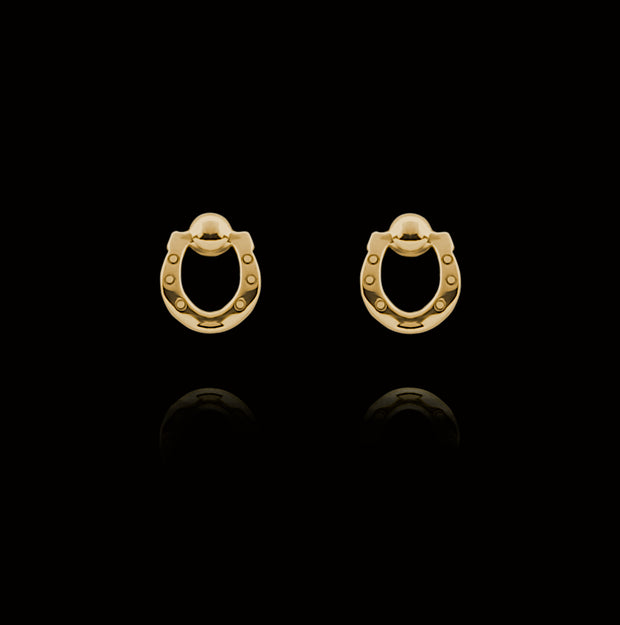 Designer solid 9ct gold horseshoe stud earrings on black background.
