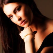 model wearing Designer solid 9ct Gold and Diamond horsebit inspired bangle