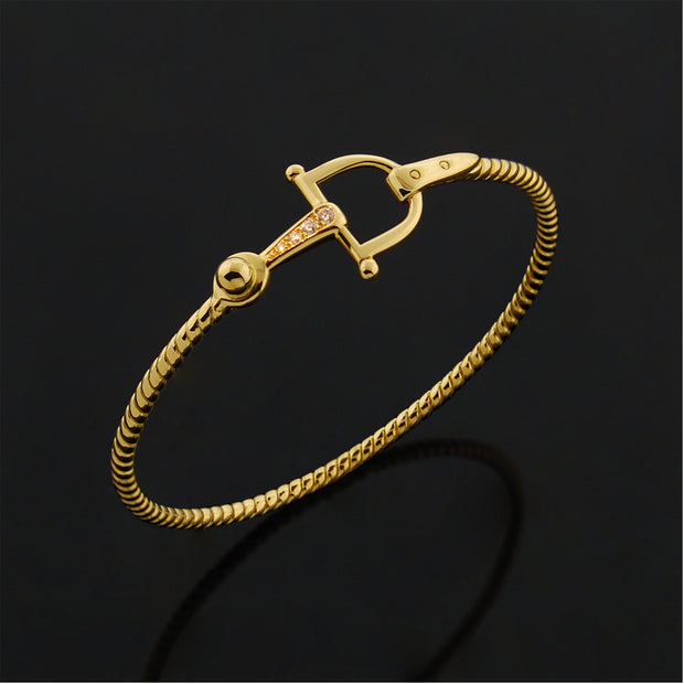 Designer solid 9ct Gold and Diamond horsebit inspired bangle on black