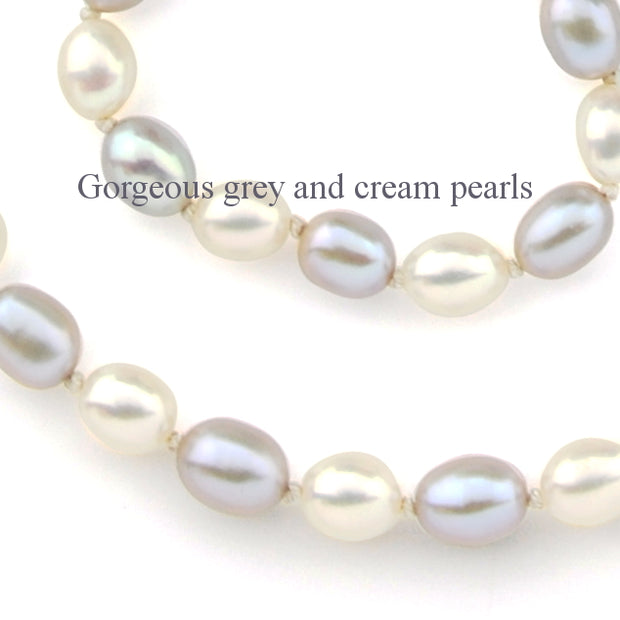 a close up image of the grey and cream colour of the cultured pearls in the necklace