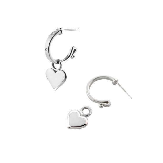 designer solid silver leather strap hoops with removable heart drop earrings on white background.