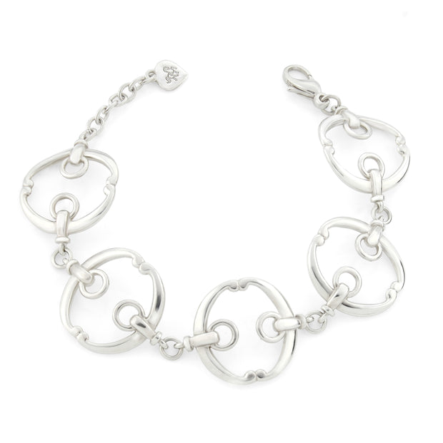 five piece solid silver designer equestrian bracelet on white background.