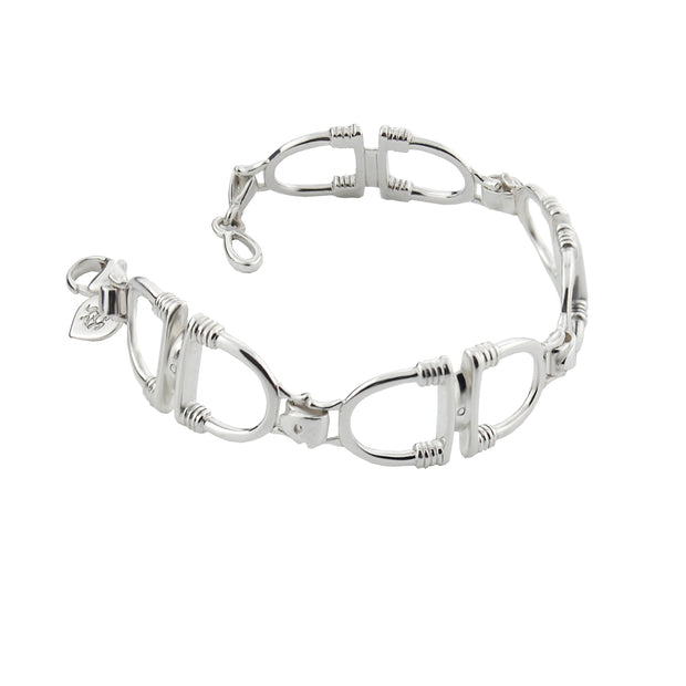 designer solid silver stirrup and leather strap bracelet on white background