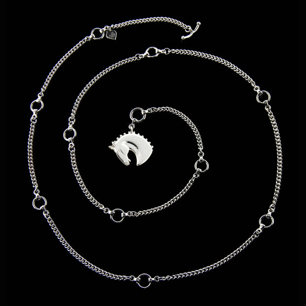 designer solid silver carved horsehead lariat chain necklace on black background
