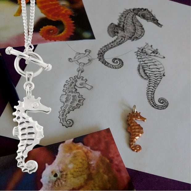 The making of a solid sterling silver designer handcarved silver seahorse necklace with toggle and ring feature clasp.