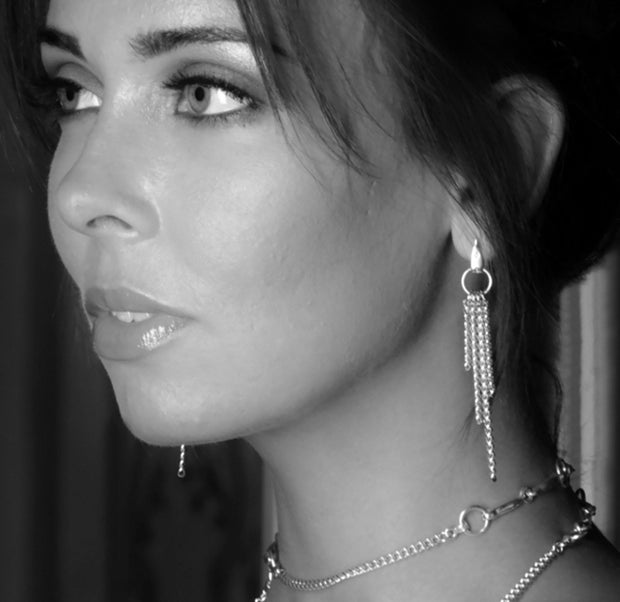 model wearing designer solid silver chain equestrian styled drop earrings Black and white image