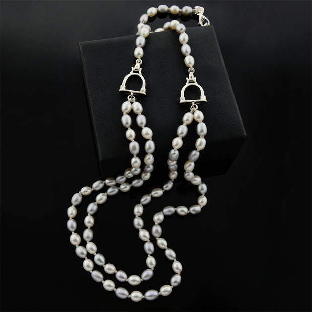 designer double strand of grey and cream pearl with stirrup detail necklace on black background