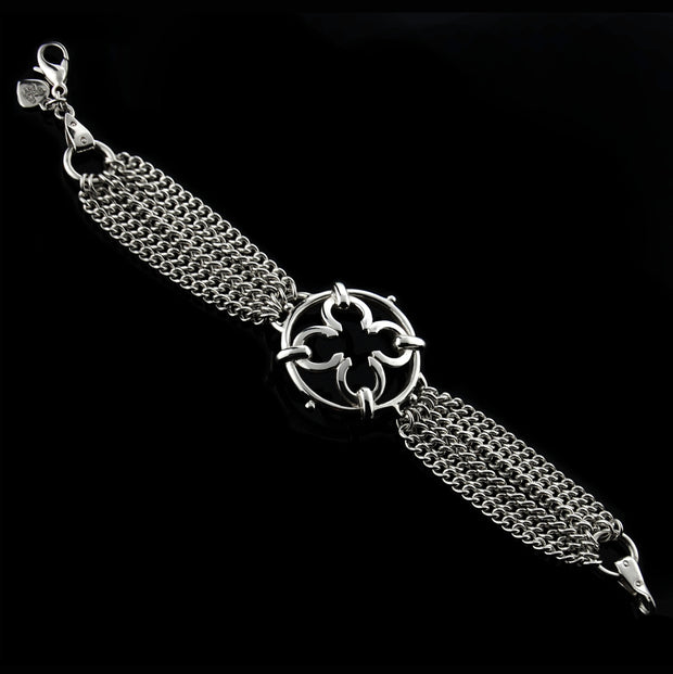 designer multistrand silver chain bracelet with wrought ironwork inspired central motif