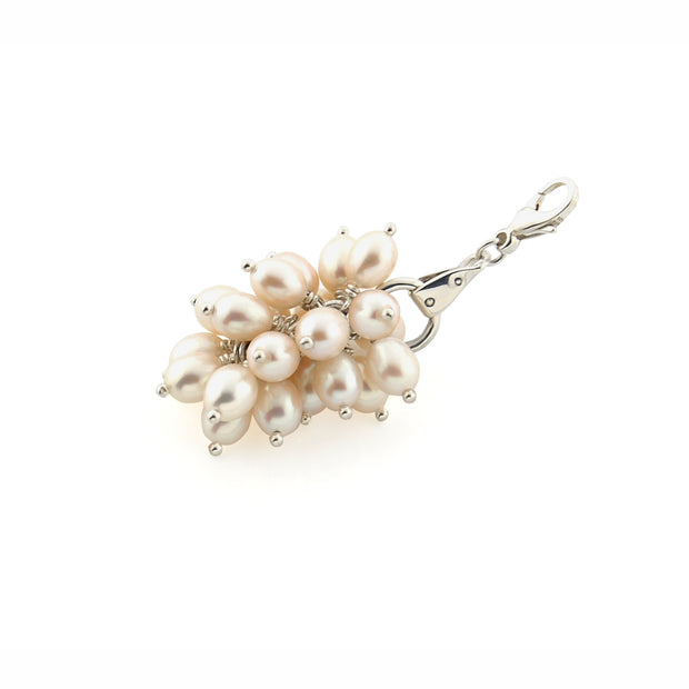 designer pearl and solid silver equestrian styled bauble with trigger clasp on white background