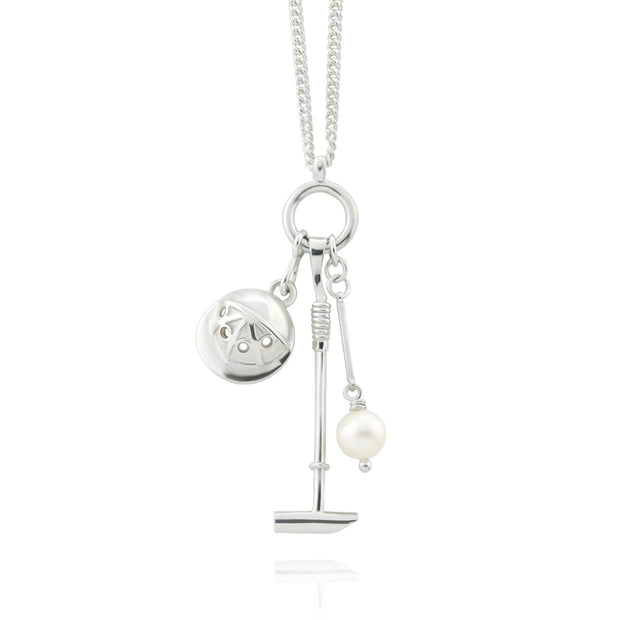 Designer Solid silver and cultured pearl polo necklace with mallet helmet and ball on white background.