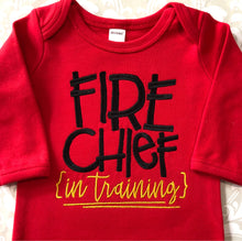 Fire chief in training red baby gown