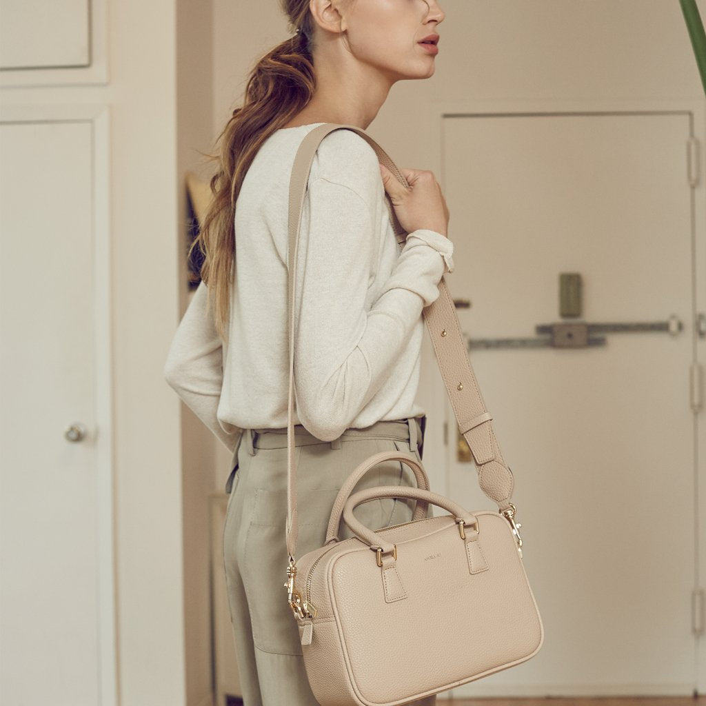 Angela Roi Vegan Barton Duffle Tote in Ecru, with model using shoulder strap