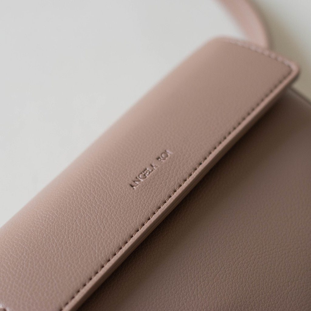 Hamilton Belt Bag / Cross-body in Taupe logo close up