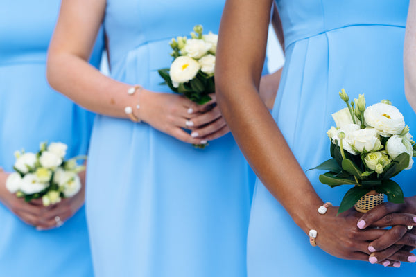 Katy in the Alexandria Wedding Gown & her bridesmaids in the Go Go Gown in Periwinkle