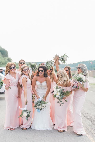 Elizabeth's bridesmaids in various gown in light pink