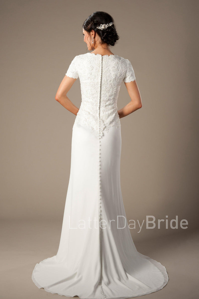 bateau lace neckline, complimented by a fitted chiffon skirt, modest utah wedding gown, back view