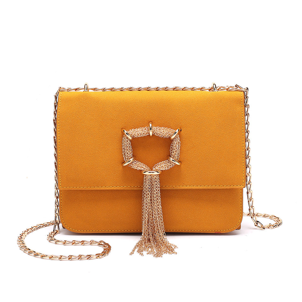 Cable chain fringed faux suede crossbody bag in Yellow