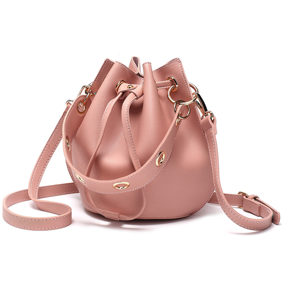 Eyelet drawstring faux leather bucket bag in Pink