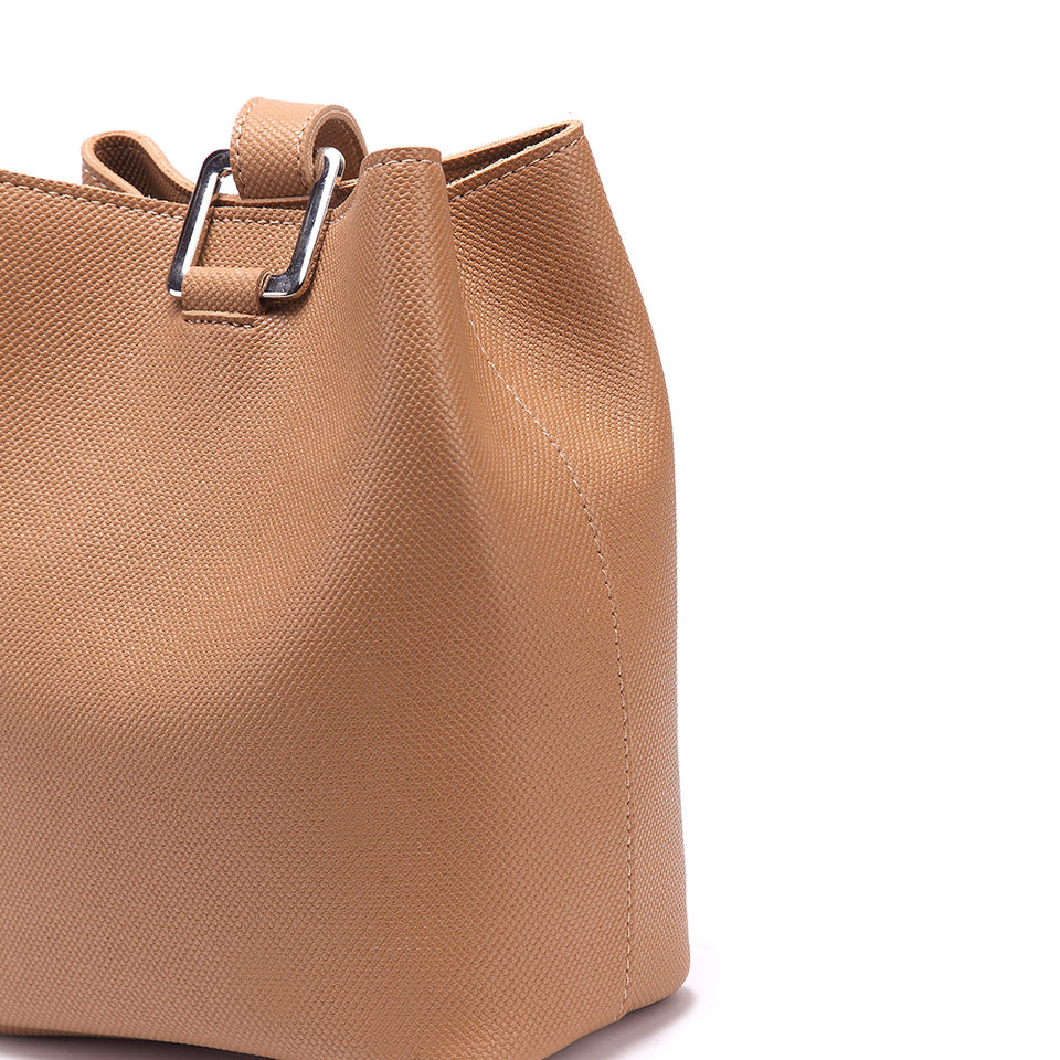 Cutout metal hardware faux leather bucket bag in Beige
