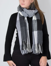 an image showing a winter knit check scarf with grey tassel