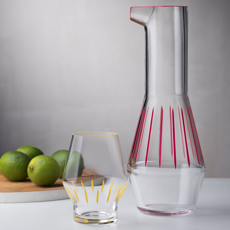 Beak Waterglass Iris collection Yellow presented together with Beak Water carafe red striped